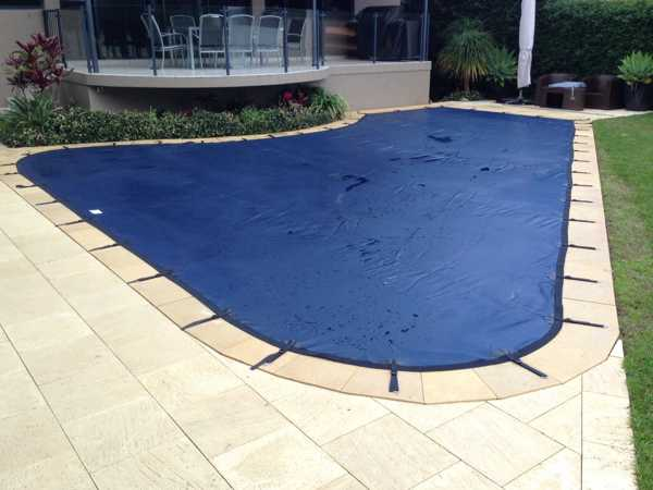 Blue leaf cover on shaped pool