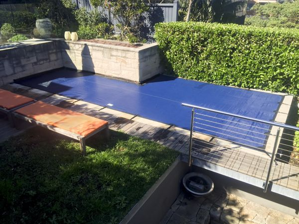 Leaf cover on Perth pool with feature wall