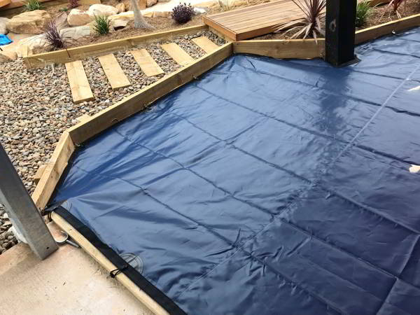 Snap hook attached sandpit cover