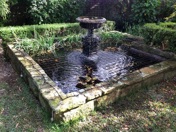 Pond Safety Net on sandstone fountain