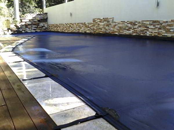 Sunshine Coast Pool Cover with Rock Wall