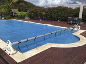Solar blanket & C-Frame roller with casters on massive pool