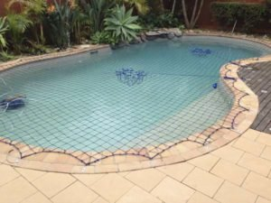 Pool Safety Net on free-form pool with rock feature