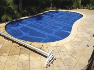 Solar blanket & C-Frame roller on gorgeous pool